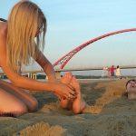 Lenka tickles Anna's Feet buried in sand!