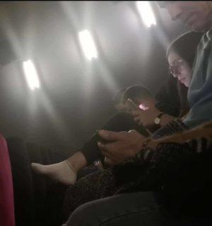 Cute brunette candid socks in the cinema