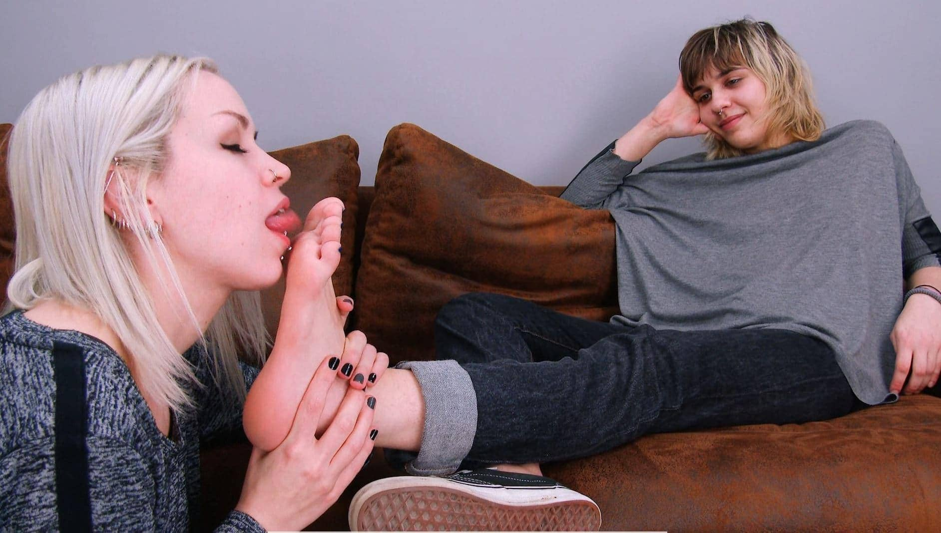 Licking her tasty soles