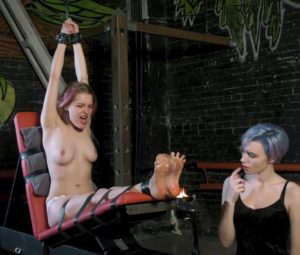 Astrid tortures soles of topless Fairy Fox with fire