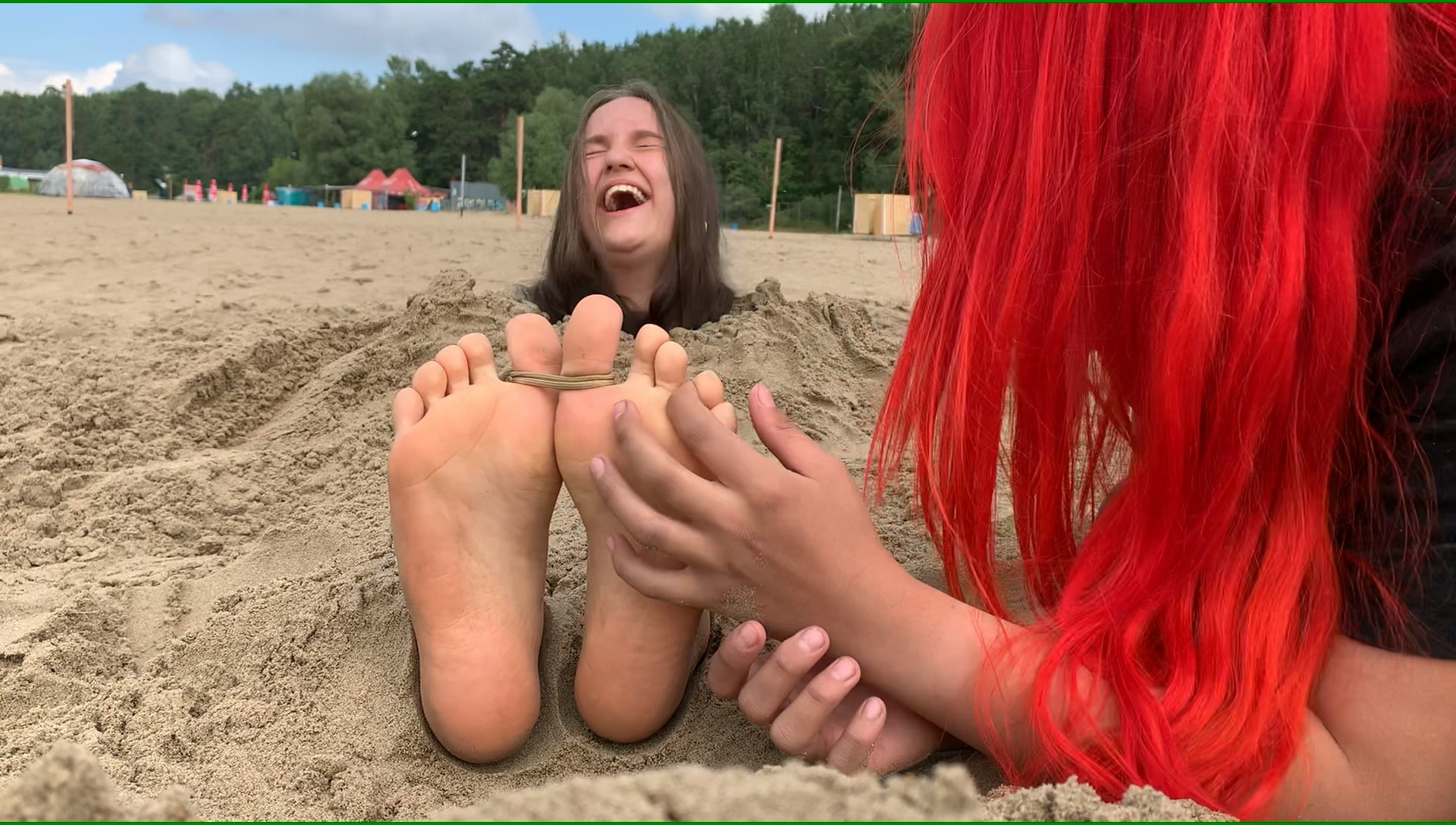 Yana tickles Julie's feet! Buried in the sand at the public beach!