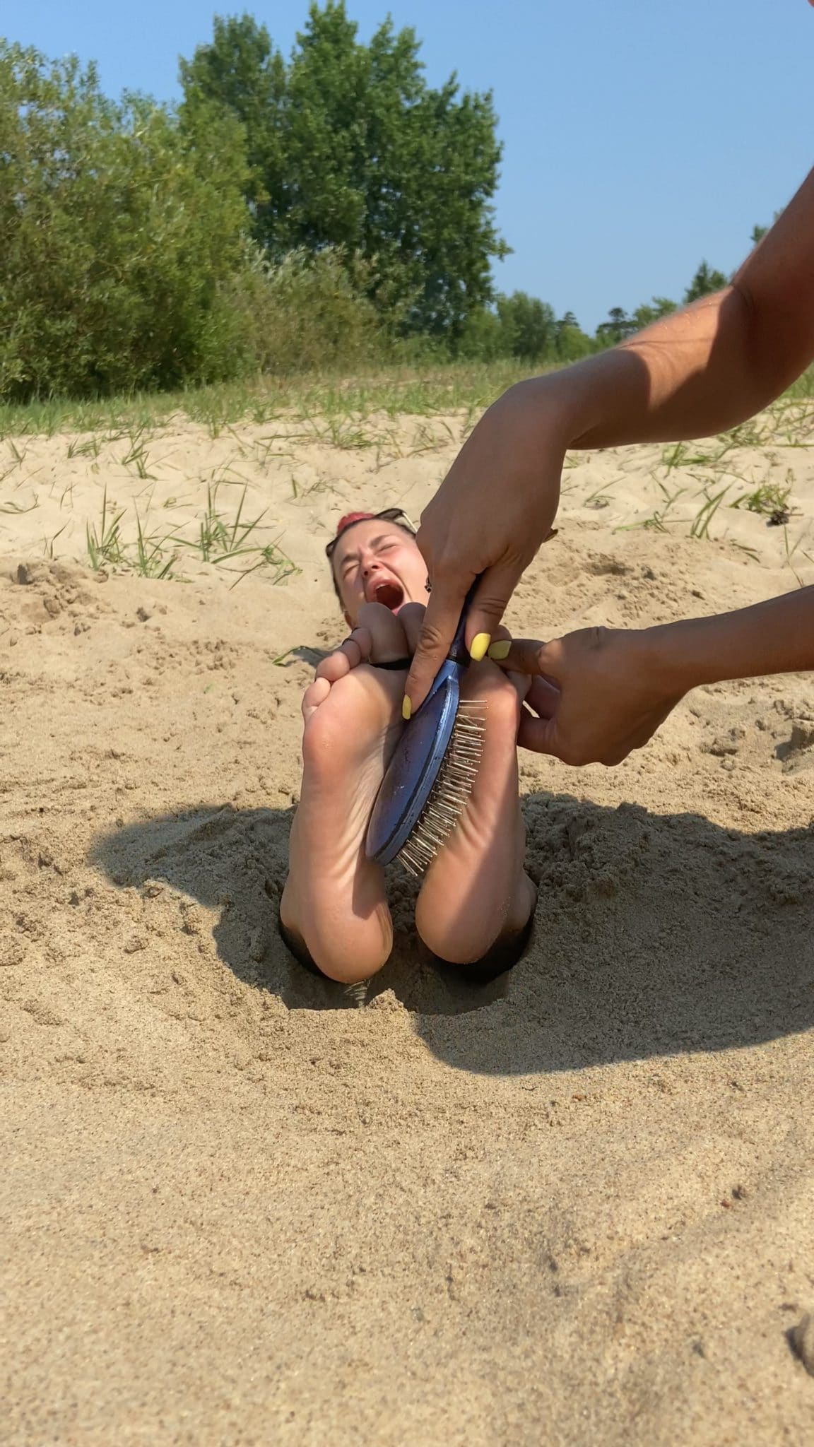Olga gets revenge and tickles Mila's Feet! Buried in the sand Public Beach tickling!