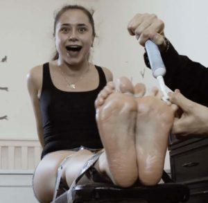 Poor Tonya suffers from feet tickling