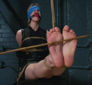 Interrogation of Astrid with tight bondage, bastinado and huge gags + Interview