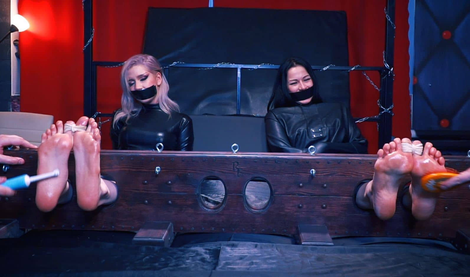 Klavdia and Taisia – Double tickling in big stocks in catsuit and straight jacket