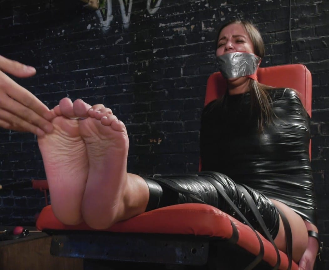 Tough bastinado challenge with tightly mummified in PVC tape Mischievous girl
